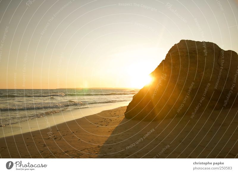 Rock in the surf Summer Summer vacation Beach Ocean Waves Cloudless sky Horizon Sun Sunrise Sunset Sunlight Beautiful weather Coast Portugal Uniqueness