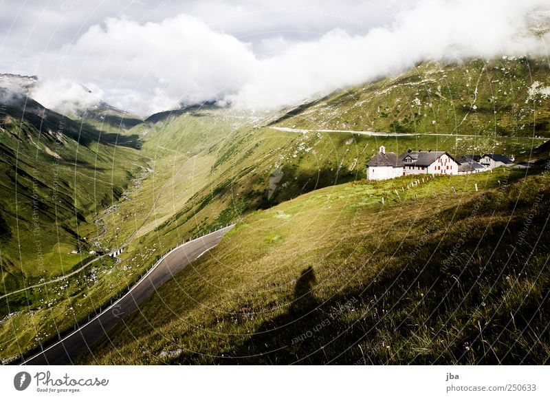 Summer Vacation & Travel Clouds Calm Loneliness Far-off places Street Wall (building) Mountain Landscape Grass Wall (barrier) Trip Tall Tourism Railroad