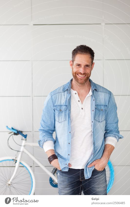 Portrait of a casual guy Lifestyle Style Happy Human being Man Adults Street Fashion Shirt Beard Think Cool (slang) Modern Retro Blue Self-confident bicycle Guy