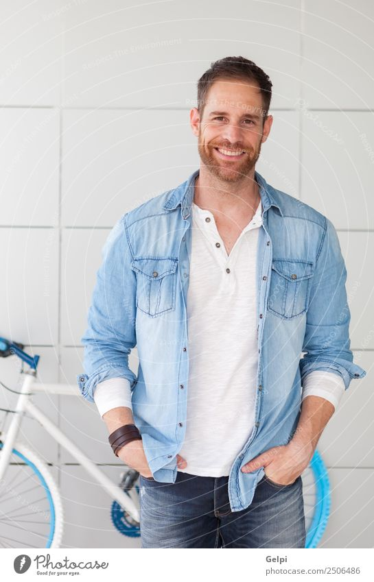 Casual guy with denim shirt and beard Lifestyle Style Happy Human being Man Adults Street Fashion Shirt Beard Think Cool (slang) Modern Retro Blue