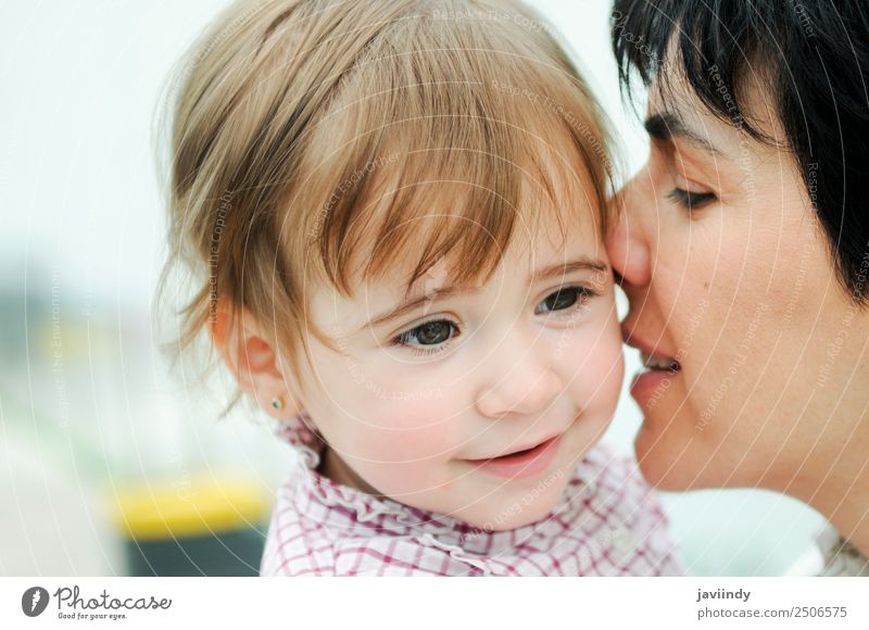 Young woman kissing her cute little daughter Lifestyle Joy Happy Beautiful Playing Child Human being Feminine Youth (Young adults) Woman Adults Parents Mother