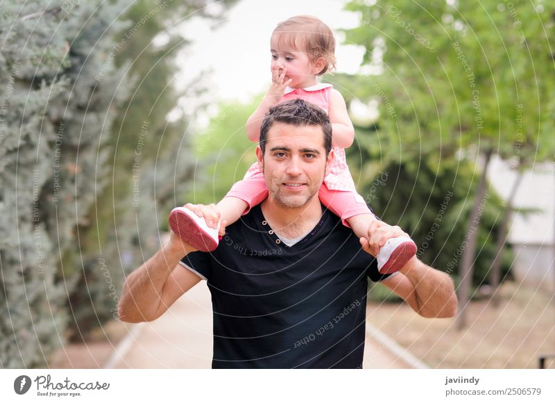 Little girl walking on the shoulders of her father in the park Parenting Child Human being Baby Toddler Girl Woman Adults Parents Father Family & Relations