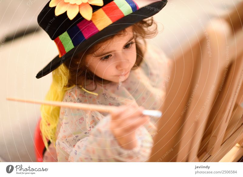 Happy little girl painting a picture at home Playing Sun Child Craft (trade) Toddler Girl Infancy 1 Human being 3 - 8 years Art Hat Smiling Small Funny Cute