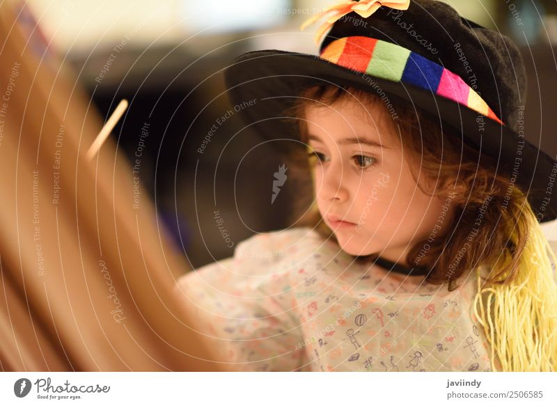 Happy little girl painting a picture at home Playing House (Residential Structure) Child Feminine Toddler Girl Infancy 1 Human being 3 - 8 years Art Hat