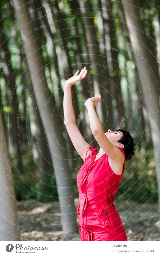 Woman dressed in red, meditating in the forest Beautiful Meditation Leisure and hobbies Feminine Young woman Youth (Young adults) Adults 1 Human being