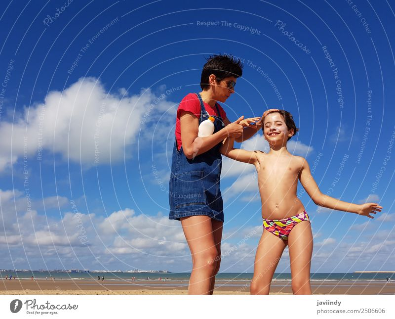 Mother and little daughter having fun on the beach in winter Woman Child Human being Vacation & Travel Youth (Young adults) Young woman Summer White Girl Beach