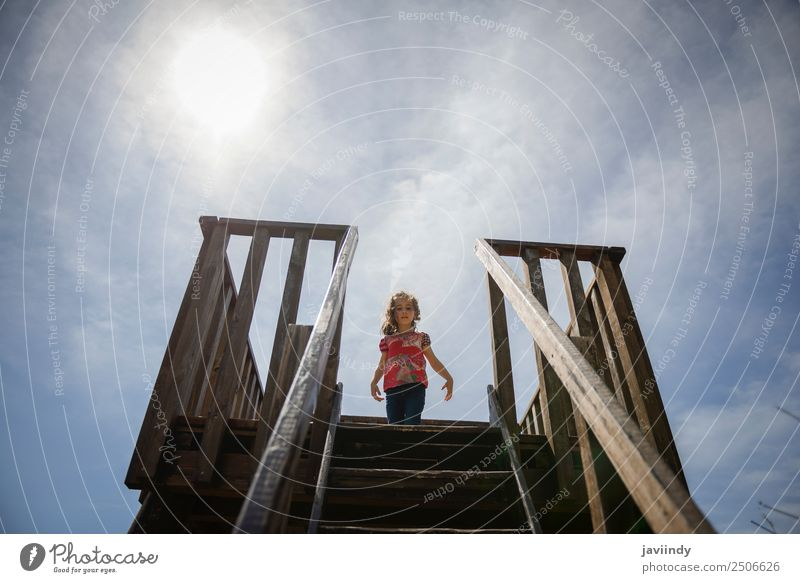 Little girl climbing to a wooden observation tower in a wetland Child Sky Nature Summer Beautiful Landscape White Joy Girl Lifestyle Funny Happy Small