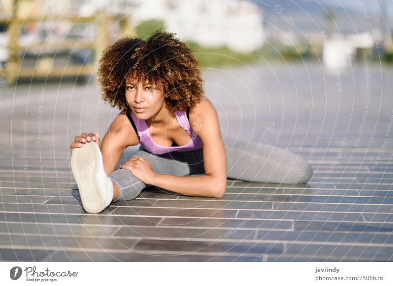Young black woman doing stretching after running outdoors Lifestyle Beautiful Hair and hairstyles Wellness Leisure and hobbies Sports Jogging Feminine