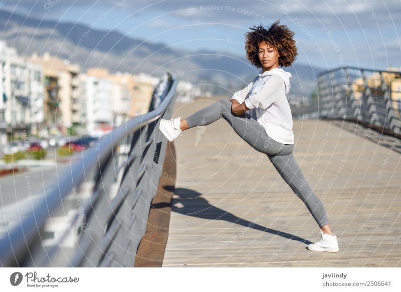 Young black woman doing stretching after running outdoors Lifestyle Beautiful Hair and hairstyles Wellness Leisure and hobbies Sports Jogging Young woman