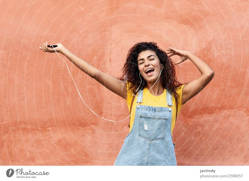 Happy woman listening to music and dancing with earphones Lifestyle Beautiful Hair and hairstyles Music Telephone Technology Young woman Youth (Young adults)