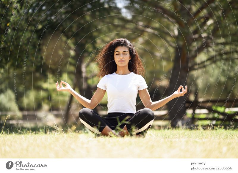 Young Arab woman doing yoga in nature. Lifestyle Hair and hairstyles Relaxation Calm Meditation Sports Yoga Human being Young woman Youth (Young adults) Woman