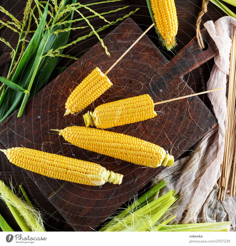 fresh yellow corn cobs Nature Old Plant Green Leaf Eating Yellow Natural Wood Brown Above Nutrition Fresh Table Vegetable Farm