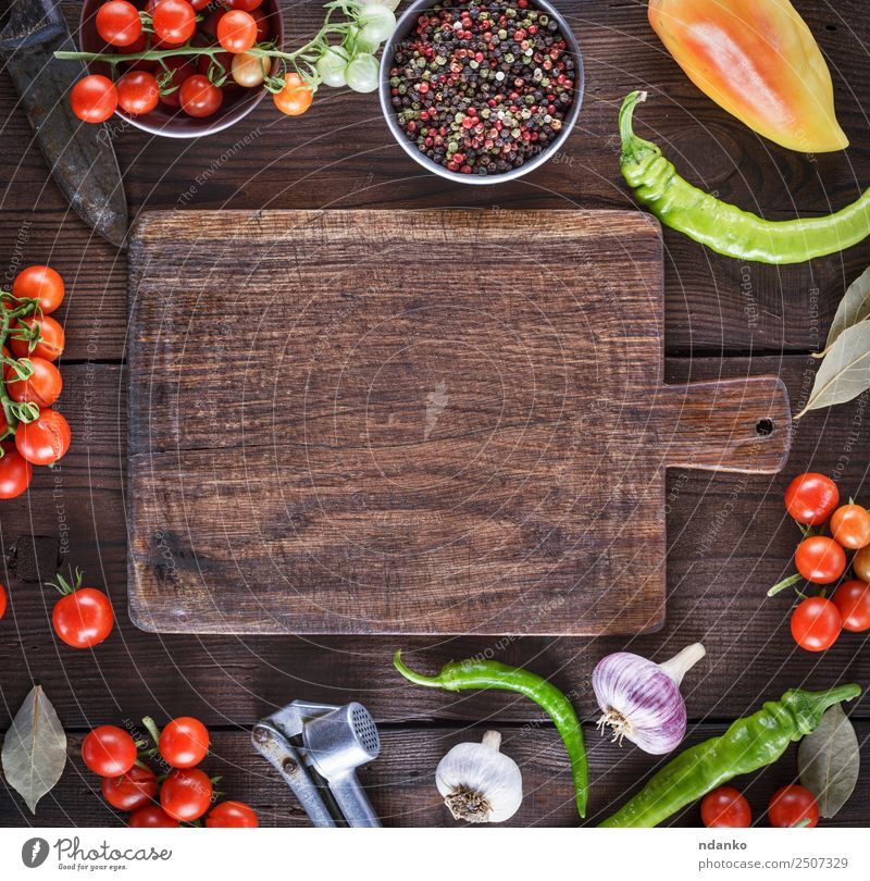 empty kitchen cutting board Vegetable Herbs and spices Chopping board Wood Eating Fresh Above Brown Yellow Red Tradition food Tomato Cherry Mature round