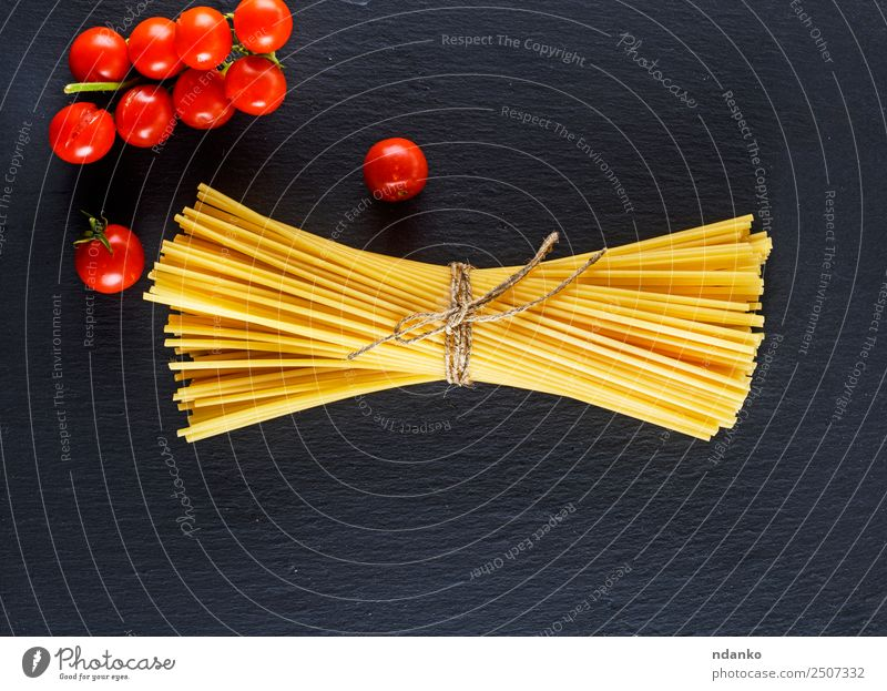 raw Italian long pasta Vegetable Dough Baked goods Vegetarian diet Italian Food Eating Fresh Large Long Above Yellow Red Black Colour Tradition Spaghetti food