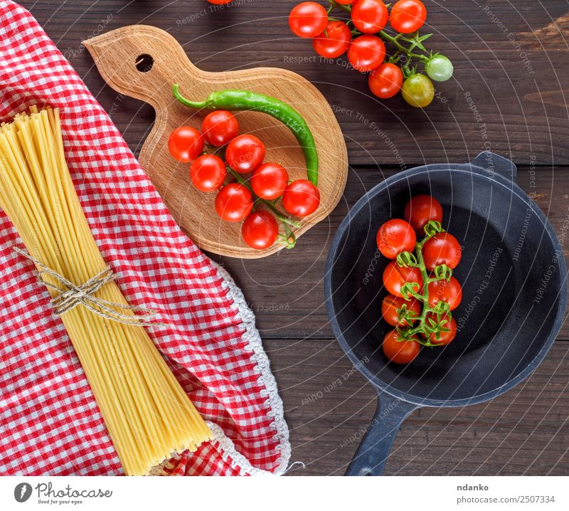 ingredients for cooking food Vegetable Dough Baked goods Italian Food Pan Wood Fresh Large Long Above Brown Yellow Red Black Tradition Spaghetti pasta Tomato