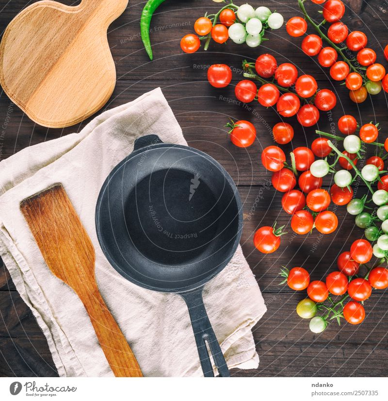 frying pan and ripe red cherry tomatoes Summer Green Red Black Natural Wood Small Copy Space Above Fresh Kitchen Vegetable Mature Vegetarian diet Tomato Salad