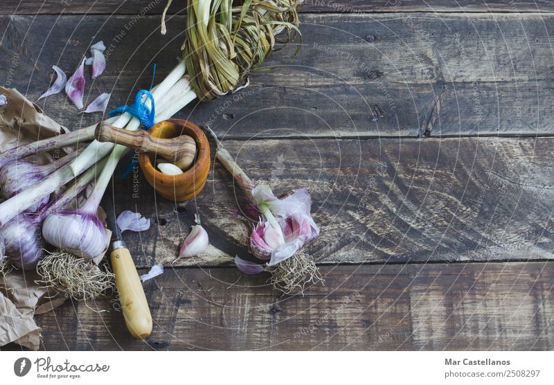Bunch of garlic with kitchenware on wooden background Nature Plant Green Eating Natural Brown Nutrition Fresh Table Herbs and spices Kitchen Violet Vegetable