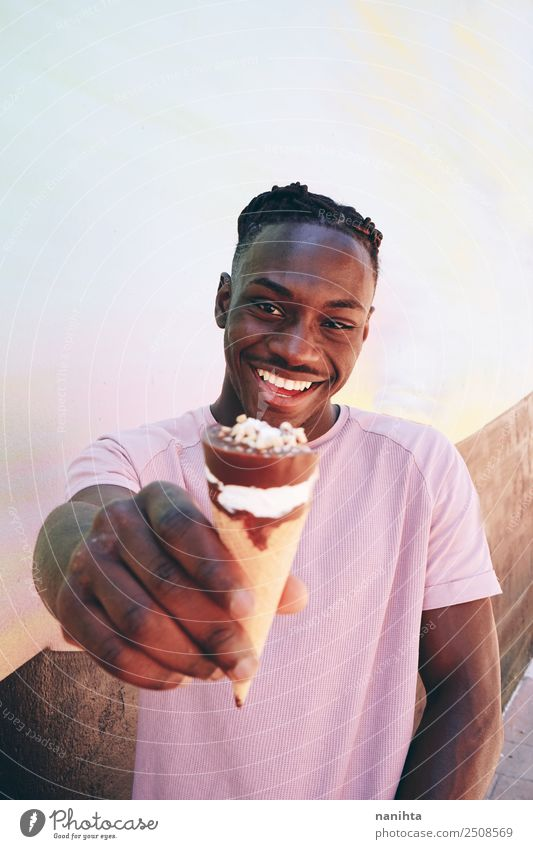Young black man holding an ice cream Food Ice cream Nutrition Eating Lifestyle Style Wellness Summer Summer vacation Human being Masculine Young man