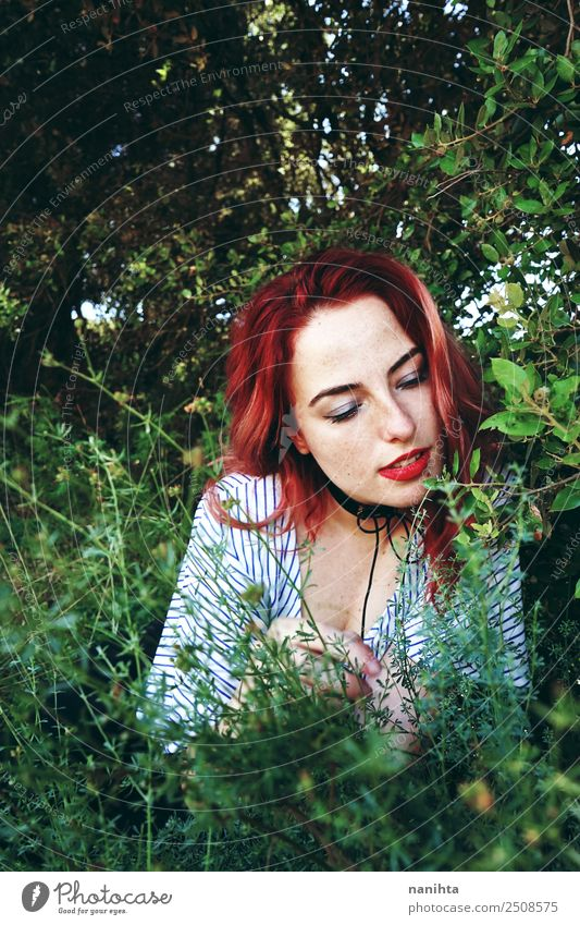 Young redhead woman surrounded by plants Human being Nature Youth (Young adults) Young woman Plant Beautiful Green Relaxation Forest 18 - 30 years Adults