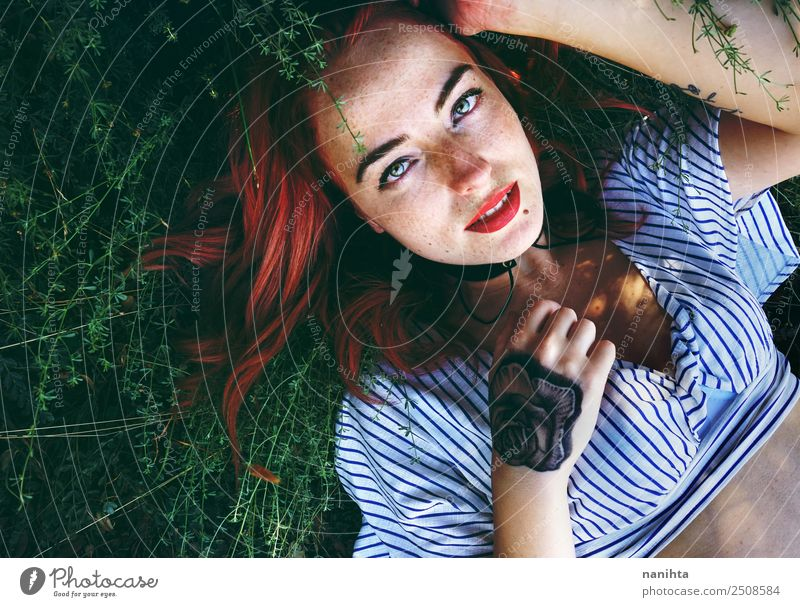 Young redhead woman lying over plants Lifestyle Style Beautiful Hair and hairstyles Skin Face Freckles Wellness Harmonious Well-being Human being Feminine