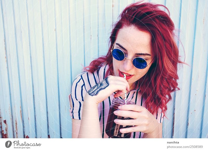Young redhead woman drinking a beverage Beverage Drinking Cold drink Juice Tea Straw Lifestyle Style Beautiful Hair and hairstyles Human being Feminine