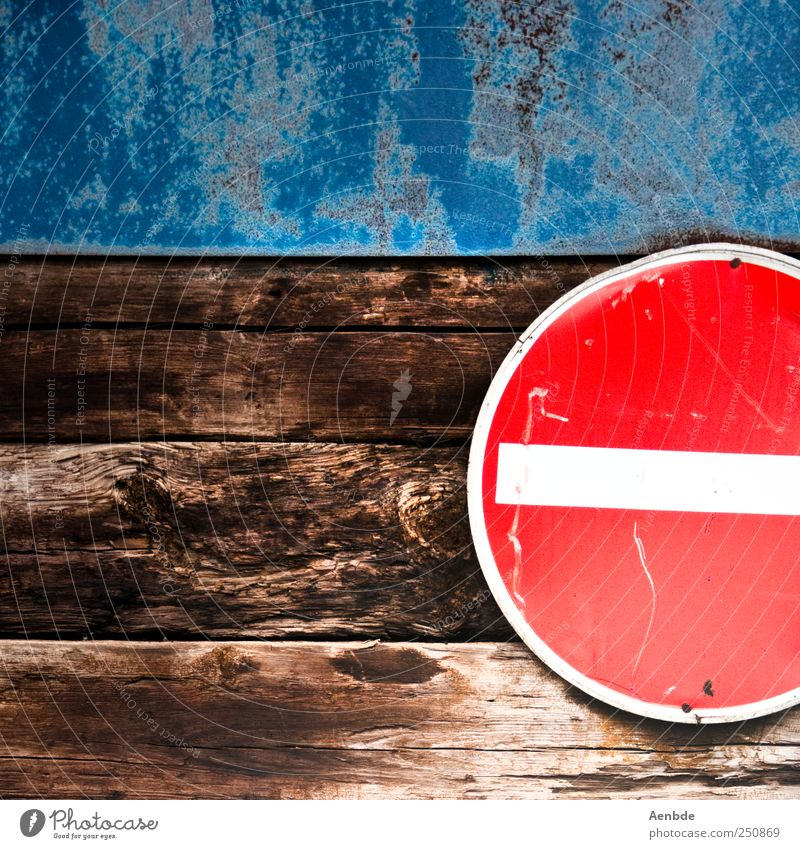 No getting through Road sign Simple Passage One-way street Red Blue Brown Wall (building) Wood Roof beams Colour photo Exterior shot Abstract Deserted