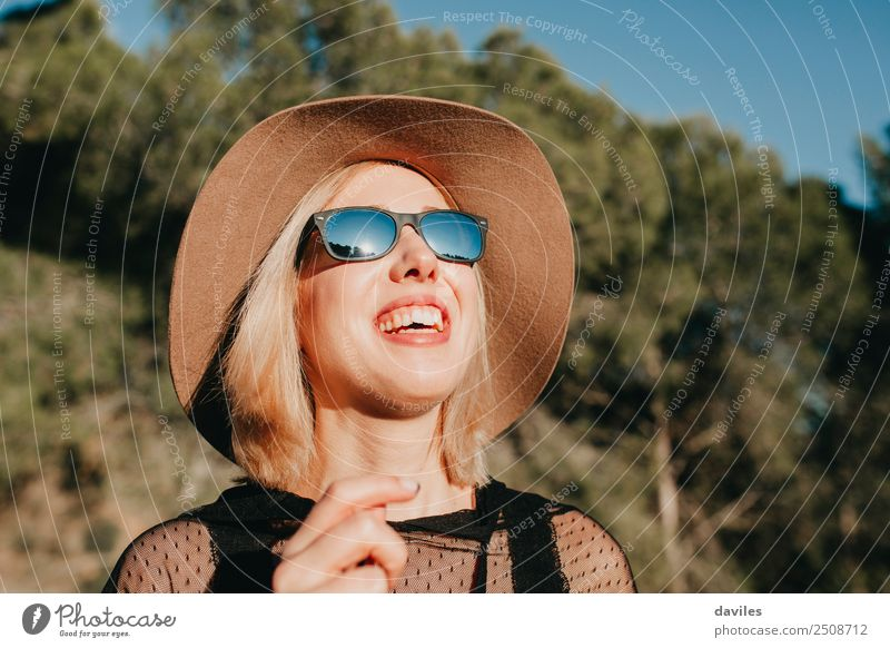 Happy blonde woman enjoying the sun in nature Human being Nature Vacation & Travel Youth (Young adults) Young woman Beautiful Landscape Tree Relaxation Joy