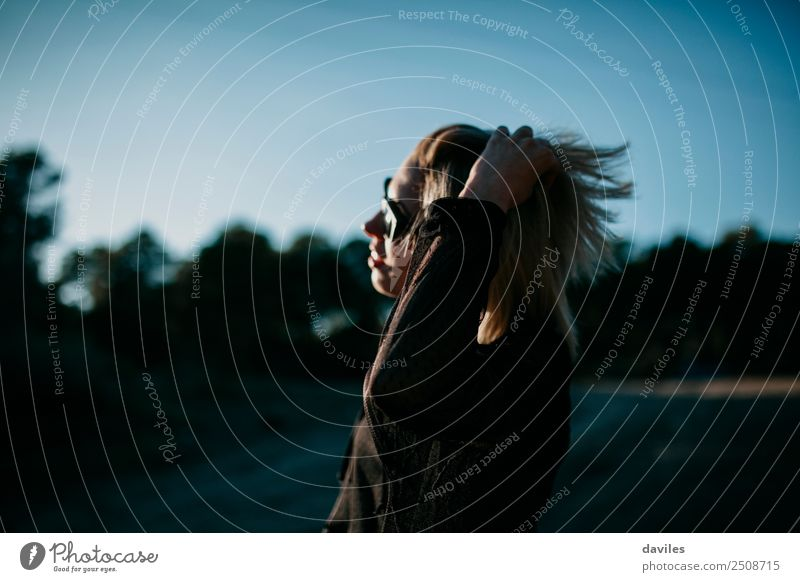 Blonde girl with sunglasses posing at sunset with a hand in the hair Lifestyle Elegant Style Beautiful Human being Feminine Young woman Youth (Young adults) 1