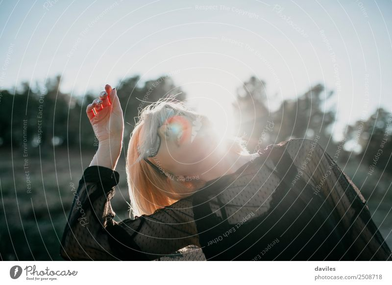 Cool blonde woman performing dance at sunset Human being Nature Youth (Young adults) Young woman Beautiful Sun White Hand Joy Forest 18 - 30 years Face Adults