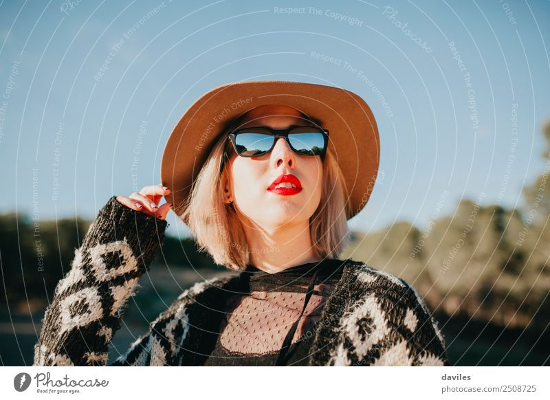 Cool blonde girl with hat and sunglasses enjoying nature Woman Human being Nature Youth (Young adults) Young woman Blue Beautiful Sun White Hand Red Forest