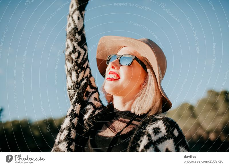 Happy woman enjoying the sunset in nature Woman Human being Nature Youth (Young adults) Young woman Blue Sun White Red Joy Forest 18 - 30 years Face Adults
