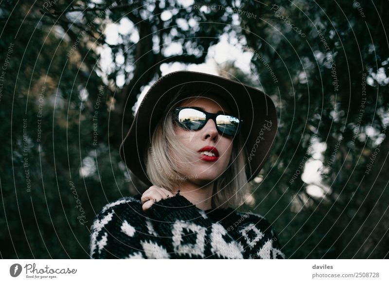 Portrait of blonde woman with sunglasses and a hat Woman Human being Nature Vacation & Travel Youth (Young adults) Young woman Tree Eroticism Forest Dark