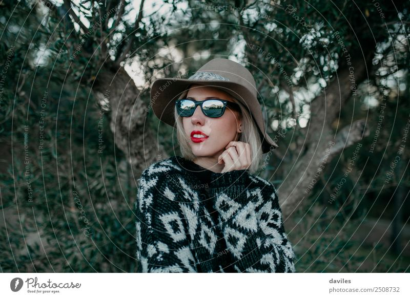 Portrait of blonde woman with sunglasses and a hat Woman Human being Nature Vacation & Travel Youth (Young adults) Young woman White Tree Red Forest Mountain