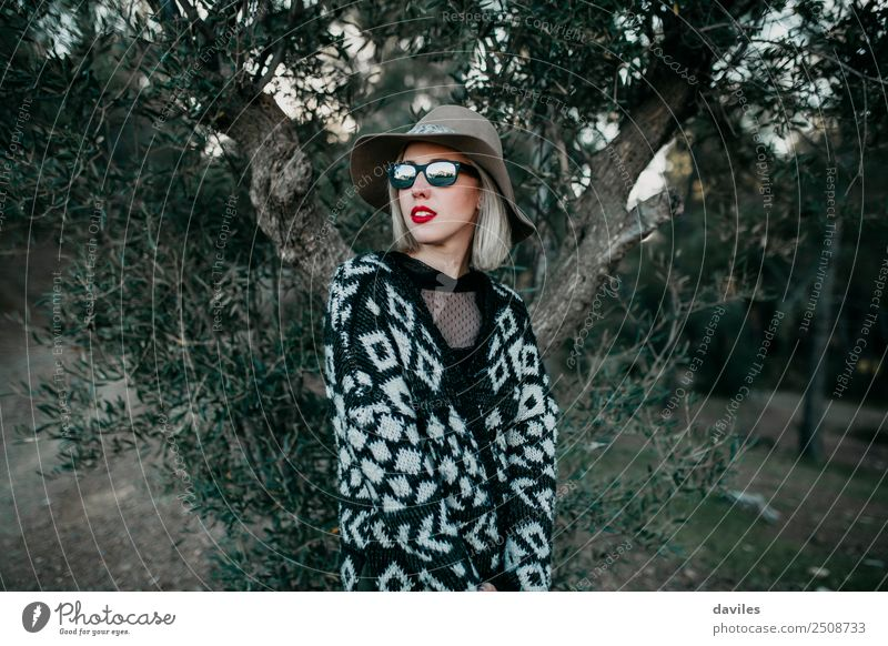 Blonde girl in hat and sunglasses posing in nature Woman Human being Nature Vacation & Travel Youth (Young adults) Young woman Beautiful White Red Forest