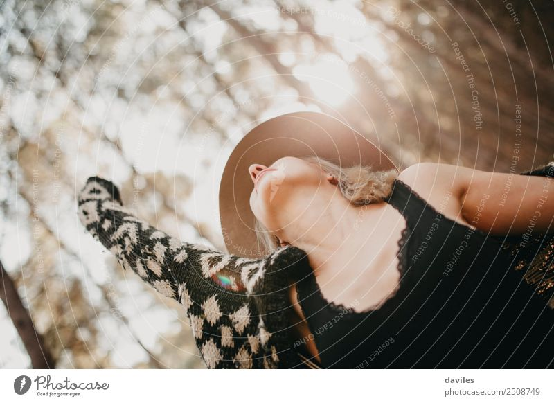 Blonde woman with a hat expressing herself and breathing in the middle of the forest. Lifestyle Joy Beautiful Health care Wellness Well-being Vacation & Travel