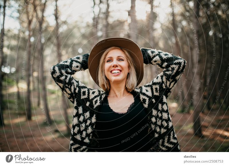 Happy smiling woman with hat in the forest Lifestyle Joy Beautiful Leisure and hobbies Vacation & Travel Adventure Freedom Human being Feminine Young woman