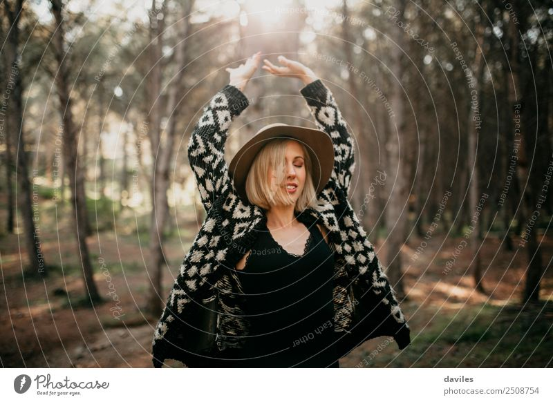Cool blonde girl with hat and black clothes dancing in the middle of the forest Lifestyle Joy Wellness Leisure and hobbies Vacation & Travel Freedom Human being