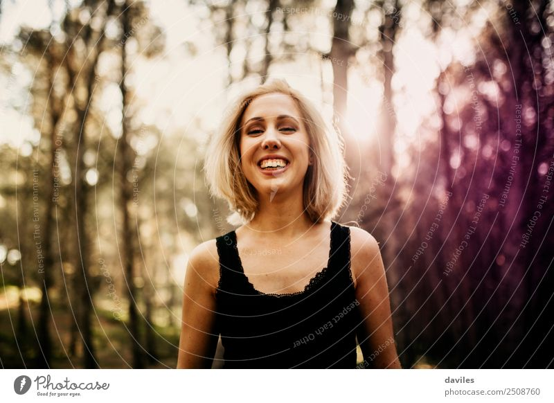 Happy blonde woman posing in the forest Human being Nature Youth (Young adults) Young woman Landscape White Tree Joy Forest 18 - 30 years Black Adults Lifestyle
