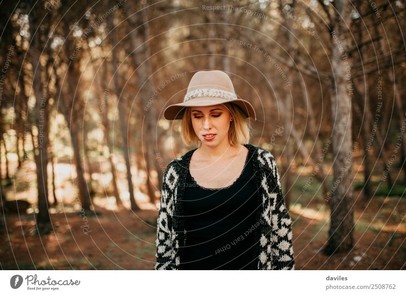 Portrait of young woman with a hat taking a walk in the forest at sunset Lifestyle Leisure and hobbies Vacation & Travel Adventure Freedom Sightseeing