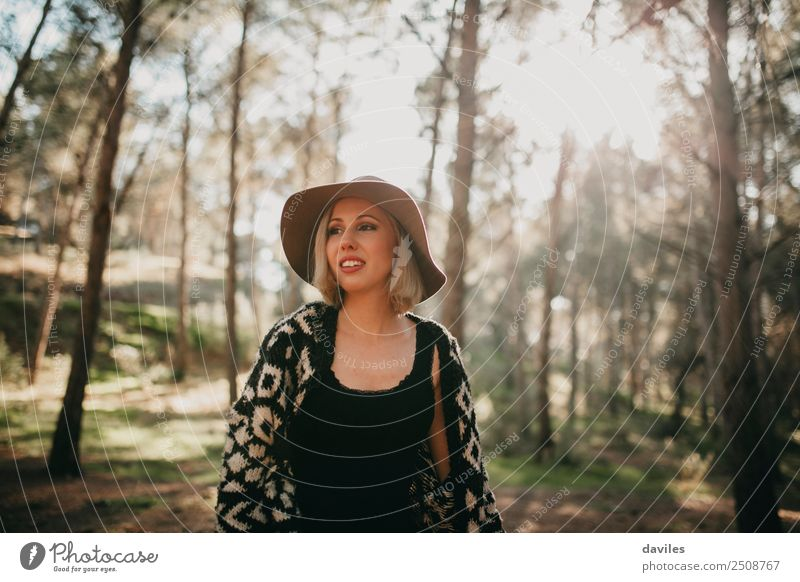 Young woman taking a walk in the forest Lifestyle Joy Leisure and hobbies Vacation & Travel Adventure Human being Feminine Youth (Young adults) Adults 1