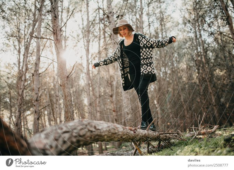 Woman walking on a fallen tree trunk Lifestyle Joy Leisure and hobbies Vacation & Travel Trip Adventure Freedom Mountain Hiking Human being Young woman