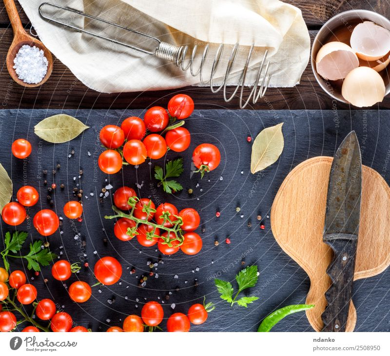 kitchen wooden board and knife Vegetable Herbs and spices Breakfast Vegetarian diet Knives Summer Kitchen Wood Fresh Small Natural Above Green Red Black