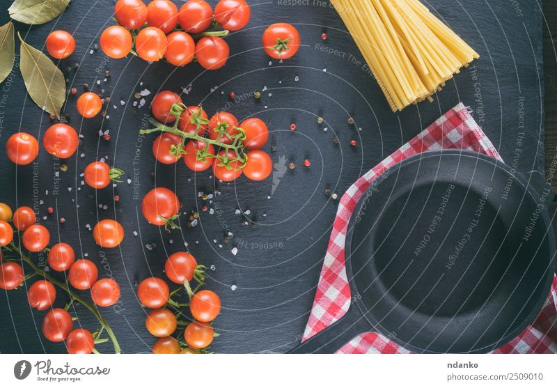 pan and ripe red cherry tomatoes Vegetable Herbs and spices Vegetarian diet Pot Pan Kitchen Eating Fresh Small Natural Above Green Red Black pasta Cherry Tomato