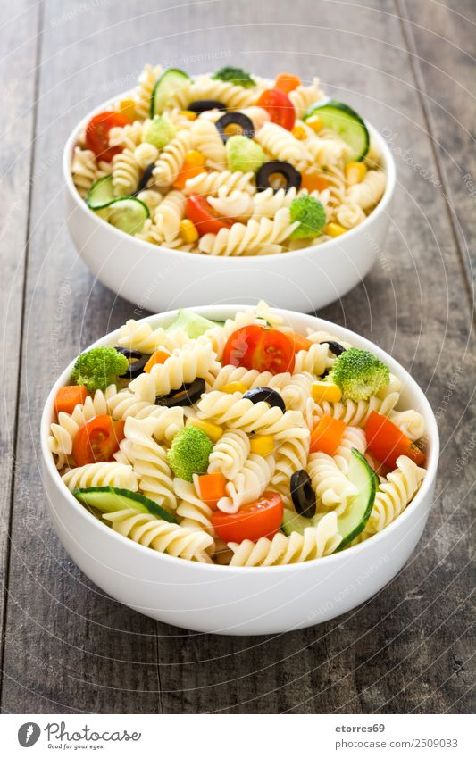 Pasta salad on wooden table. Food Healthy Eating Food photograph Dish Vegetable Lettuce Salad Dough Baked goods Nutrition Vegetarian diet Bowl Summer Fresh Good