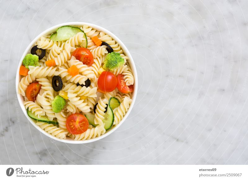Pasta salad Food Vegetable Lettuce Salad Dough Baked goods Nutrition Bowl Healthy Summer Fresh Good Green Red Tomato Broccoli Olive Cucumber Marble Copy Space