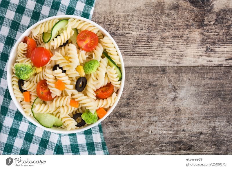 Pasta salad with vegetables in bowl on wood Food Vegetable Lettuce Salad Dough Baked goods Nutrition Lunch Organic produce Vegetarian diet Diet Bowl Wood