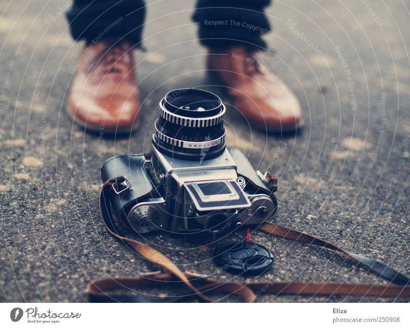 Human being Old Footwear Lie Esthetic Floor covering Camera Leather Vintage