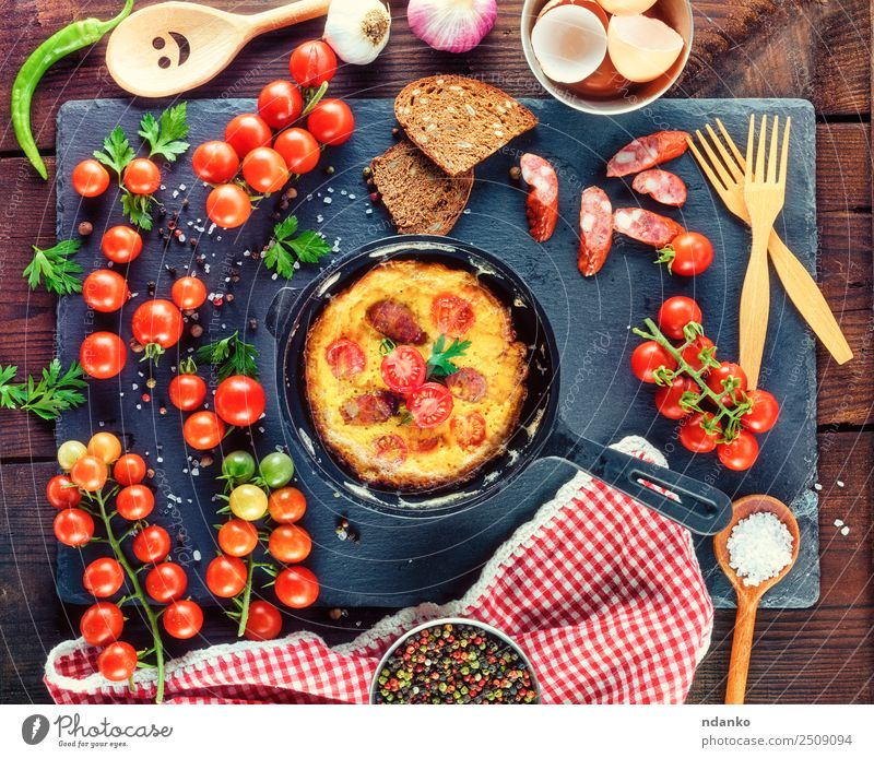 frying pan with fried omelette Sausage Vegetable Bread Breakfast Lunch Dinner Pan Fork Spoon Table Eating Fresh Above Yellow Green Tradition Omelette