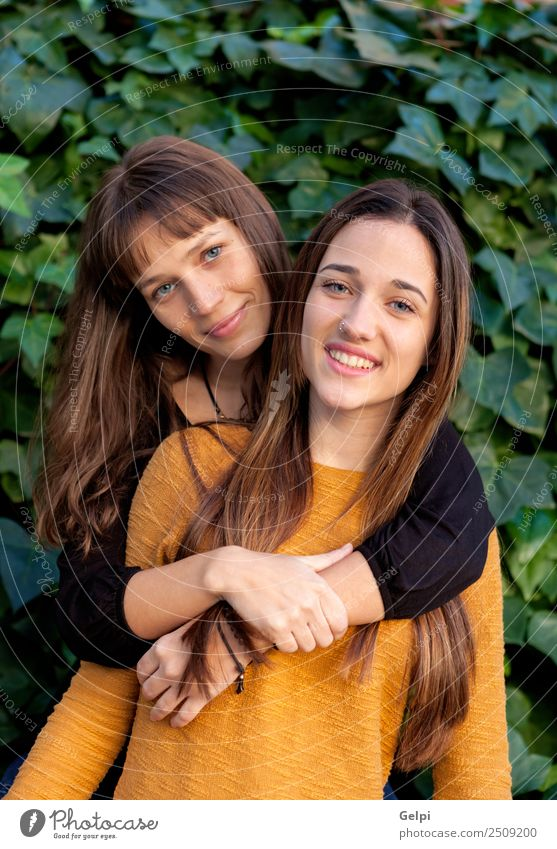 Nice sisters with blue eyes Lifestyle Joy Happy Beautiful Human being Woman Adults Sister Family & Relations Friendship Youth (Young adults) Teeth Park Piercing