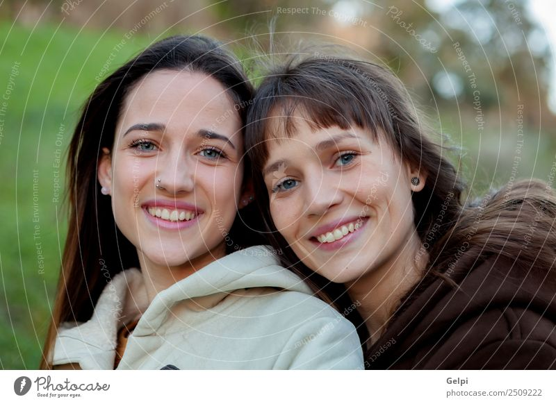 Nice sisters with blue eyes Lifestyle Joy Happy Beautiful Face Human being Woman Adults Sister Family & Relations Friendship Youth (Young adults) Teeth Park
